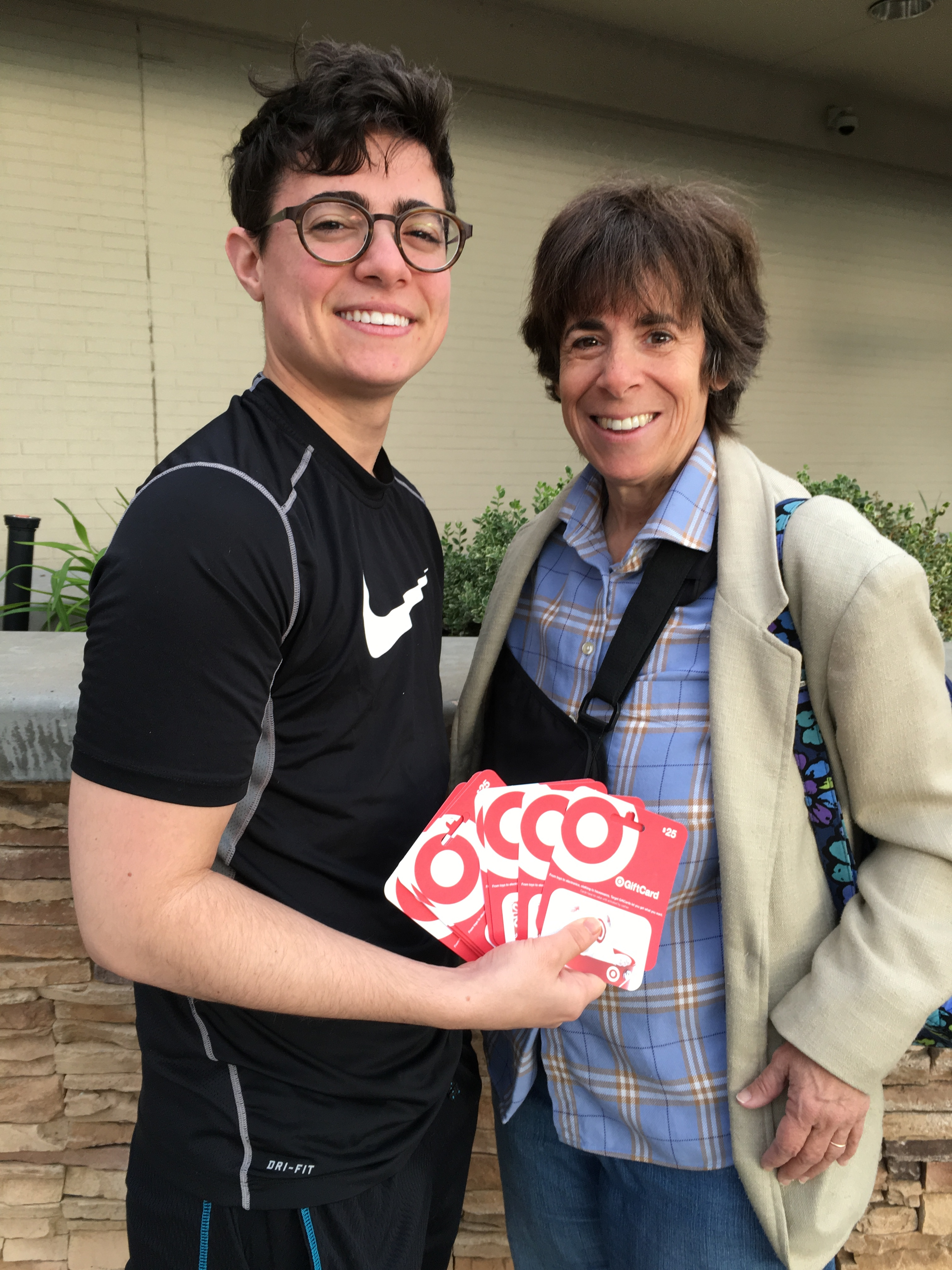 Author with her transgender son, Jeremy, displaying Target gift cards in appreciation for the store's commitment to trans rights.